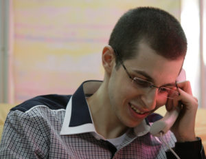 Israeli soldier Gilad Shalit speaks to his parents on the phone soon after being released from captivity on October 18, 2011. Photo by IDF Spokesperson/FLASH90
