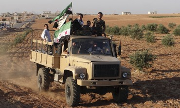 UK reportedly planning to provide military aid to Syria rebels